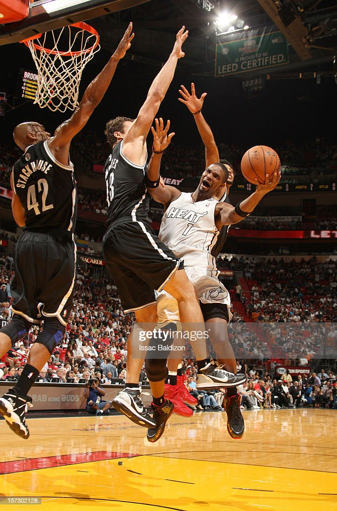 Chris Bosh #1 of the Miami Heat goes to the basket during a game between the Brooklyn Nets and the Miami Heat on December 1, 2012 at American Airlines Arena in Miami, Florida.