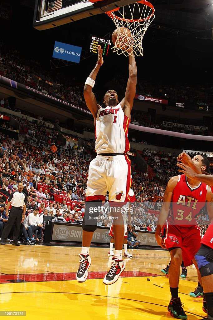 Chris Bosh #1 of the Miami Heat goes to the basket during a game between the Atlanta Hawks and the Miami Heat on December 10, 2012 at American Airlines Arena in Miami, Florida.