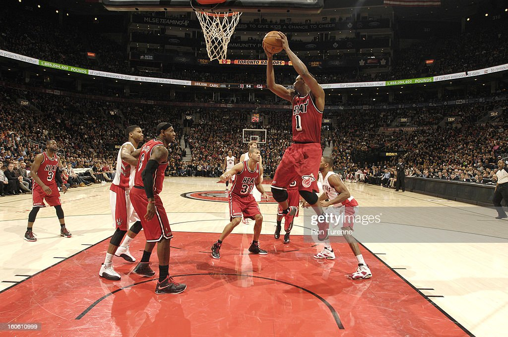<a gi-track='captionPersonalityLinkClicked' href=/galleries/search?phrase=Chris+Bosh&family=editorial&specificpeople=201574 ng-click='$event.stopPropagation()'>Chris Bosh</a> #1 of the Miami Heat goes to the basket during the game between the Toronto Raptors and the Miami Heat during the game on February 3, 2013 at the Air Canada Centre in Toronto, Ontario, Canada.