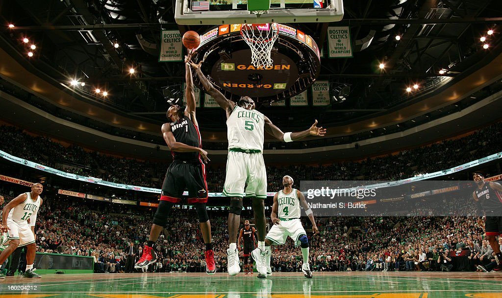Chris Bosh #1 of the Miami Heat goes up for a rebound against Kevin Garnett #5 of the Boston Celtics on January 27, 2013 at TD Garden in Boston, Massachusetts.