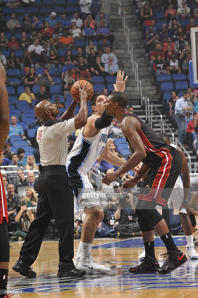 <a gi-track='captionPersonalityLinkClicked' href=/galleries/search?phrase=Chris+Bosh&family=editorial&specificpeople=201574 ng-click='$event.stopPropagation()'>Chris Bosh</a> #1 of the Miami Heat goes up for the opening tip against the Orlando Magic during the game on November 20, 2013 at Amway Center in Orlando, Florida.
