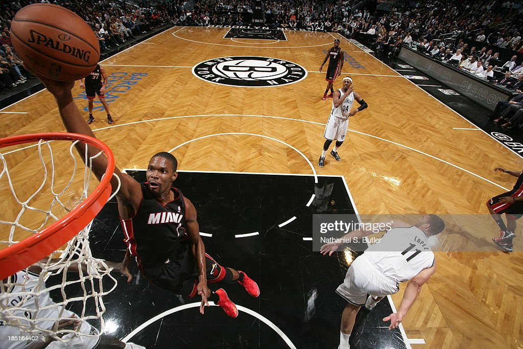 Chris Bosh #1 of the Miami Heat goes up to dunk during a preseason game against the Brooklyn Nets at the Barclays Center on October 17, 2013 in the Brooklyn borough of New York City.