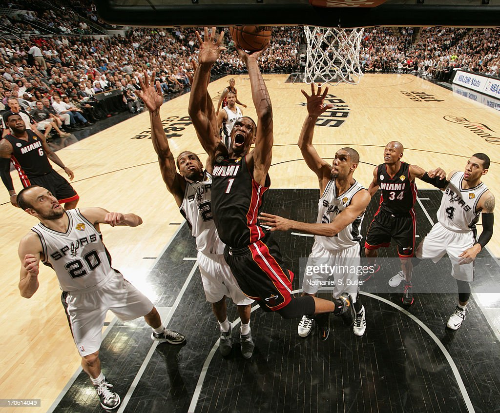 Chris Bosh #1 of the Miami Heat goes up to shoot while playing against the San Antonio Spurs in Game Four of the 2013 NBA Finals on June 13, 2013 at the AT&T Center in San Antonio, Texas.