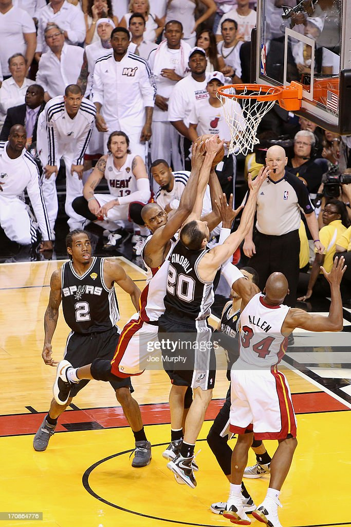 Chris Bosh #1 of the Miami Heat grabs a key rebound against the San Antonio Spurs in Game Six of the 2013 NBA Finals on June 18, 2013 at American Airlines Arena in Miami, Florida.