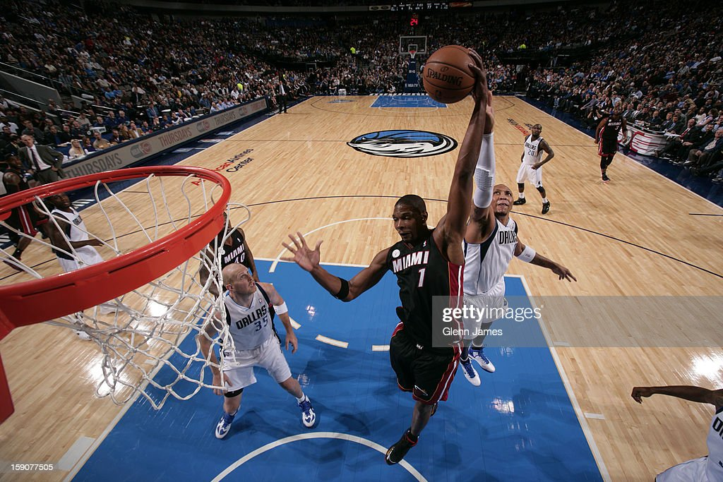 <a gi-track='captionPersonalityLinkClicked' href=/galleries/search?phrase=Chris+Bosh&family=editorial&specificpeople=201574 ng-click='$event.stopPropagation()'>Chris Bosh</a> #1 of the Miami Heat grabs a rebound against the Dallas Mavericks on December 20, 2012 at the American Airlines Center in Dallas, Texas.