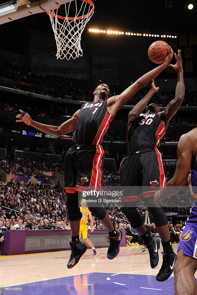Chris Bosh #1 of the Miami Heat grabs the rebound against the Los Angeles Lakers at Staples Center on January 17, 2013 in Los Angeles, California.