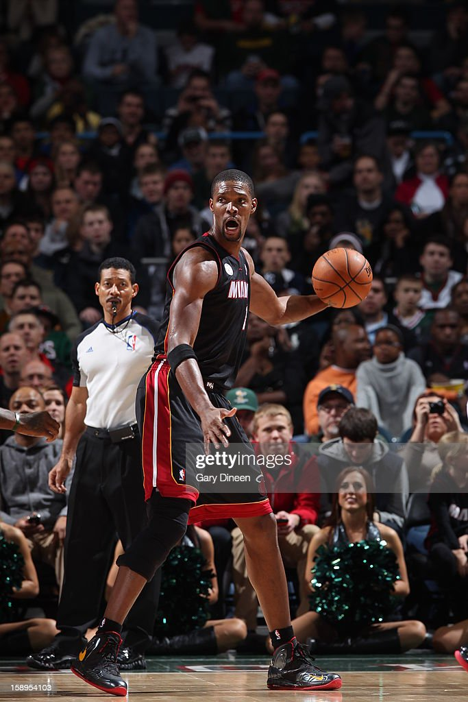 <a gi-track='captionPersonalityLinkClicked' href=/galleries/search?phrase=Chris+Bosh&family=editorial&specificpeople=201574 ng-click='$event.stopPropagation()'>Chris Bosh</a> #1 of the Miami Heat handles the ball against the Milwaukee Bucks on December 29, 2012 at the BMO Harris Bradley Center in Milwaukee, Wisconsin.