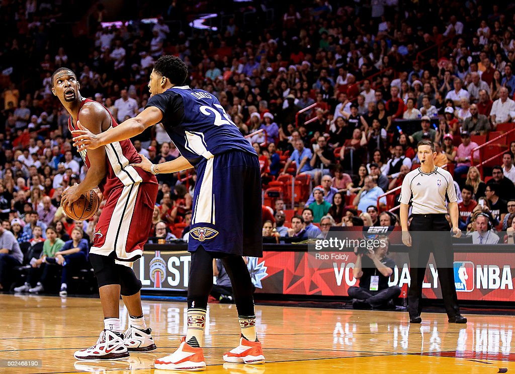 Chris Bosh #1 of the Miami Heat is defended by Anthony Davis #23 of the New Orleans Pelicans during the game at American Airlines Arena on December 25, 2015 in Miami, Florida.