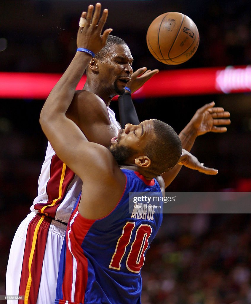 Chris Bosh #1 of the Miami Heat is fouled by Greg Monroe #10 of the Detroit Pistons during a game at American Airlines Arena on March 22, 2013 in Miami, Florida.