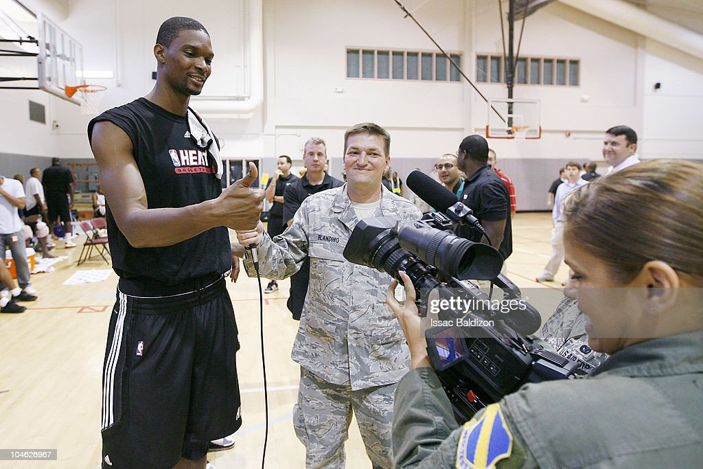 <a gi-track='captionPersonalityLinkClicked' href=/galleries/search?phrase=Chris+Bosh&family=editorial&specificpeople=201574 ng-click='$event.stopPropagation()'>Chris Bosh</a> (L) of the Miami Heat is interviewed by media after training camp on October 1, 2010 at Aderholt Gym in Hurlburt Field, Florida.