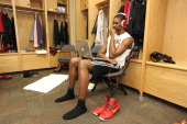 Chris Bosh of the Miami Heat looks at his laptop in the locker room prior to Game One of the 2012 NBA Finals against Oklahoma City Thunder at the...