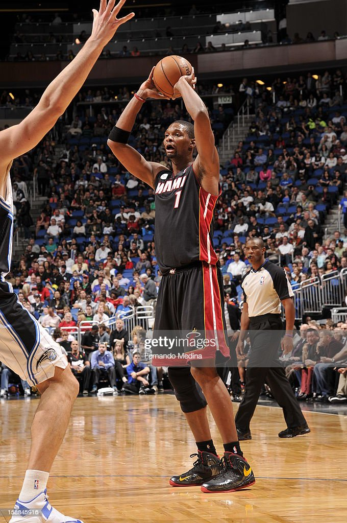 Chris Bosh #1 of the Miami Heat looks downlow to pass the ball against the Orlando Magic during the game on December 31, 2012 at Amway Center in Orlando, Florida.