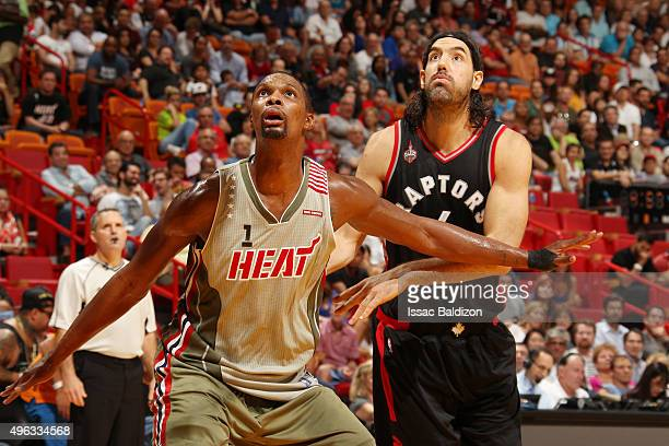 Chris Bosh of the Miami Heat looks for the rebound against Luis Scola of the Toronto Raptors during the game on November 8 2015 at American Airlines...