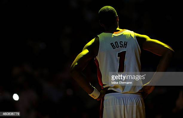 Chris Bosh of the Miami Heat looks on during a a game against the Toronto Raptors at AmericanAirlines Arena on January 5 2014 in Miami Florida NOTE...