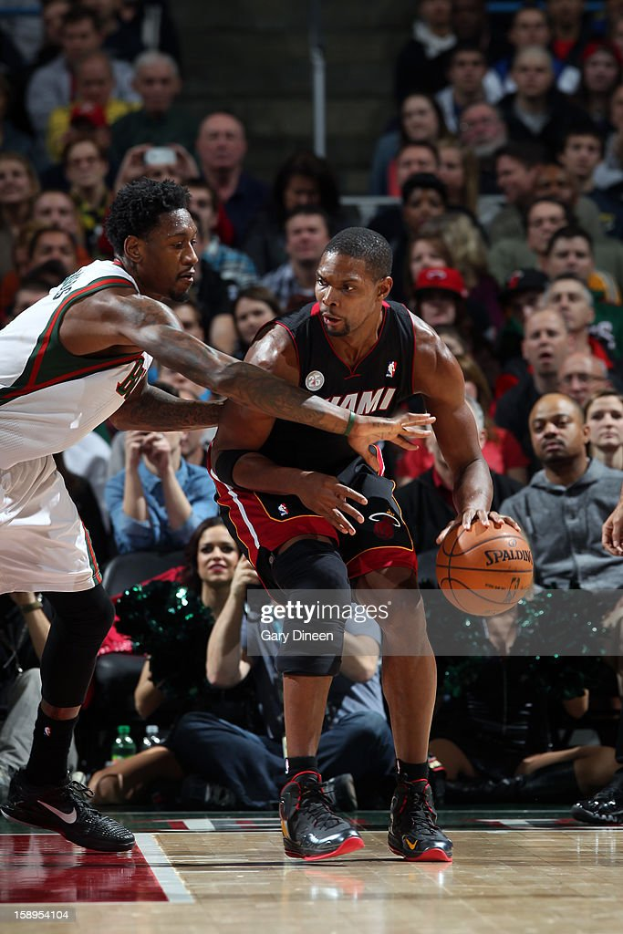 <a gi-track='captionPersonalityLinkClicked' href=/galleries/search?phrase=Chris+Bosh&family=editorial&specificpeople=201574 ng-click='$event.stopPropagation()'>Chris Bosh</a> #1 of the Miami Heat looks to make a move against Larry Sanders #8 of the Milwaukee Bucks on December 29, 2012 at the BMO Harris Bradley Center in Milwaukee, Wisconsin.