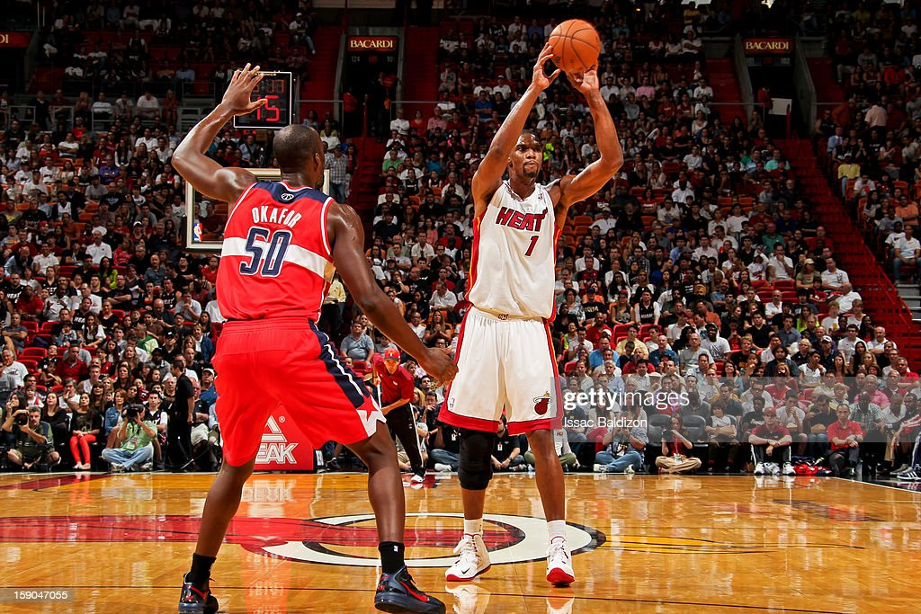 Chris Bosh #1 of the Miami Heat looks to pass the ball against Emeka Okafor #50 of the Washington Wizards on January 6, 2013 at American Airlines Arena in Miami, Florida.