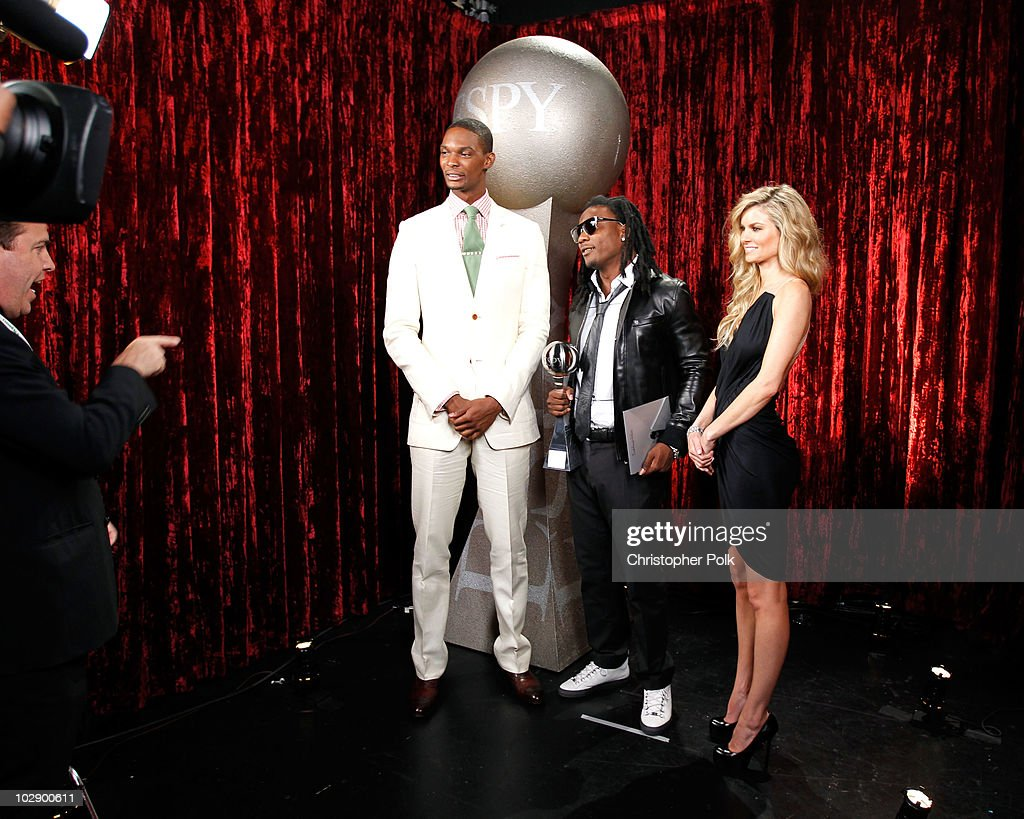 Chris Bosh of the Miami Heat NFL player Chris Johnson and model Marisa Miller pose backstage at the 2010 ESPY Awards at Nokia Theatre LA Live on July...