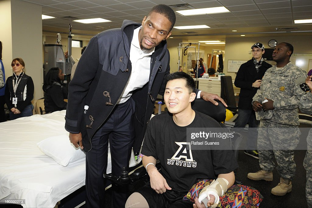 Chris Bosh of the Miami Heat poses for a picture with serviceman Jason Pak during a visit to Walter Reed National Military Medical Center on January 28, 2012 Bethesda, MD.
