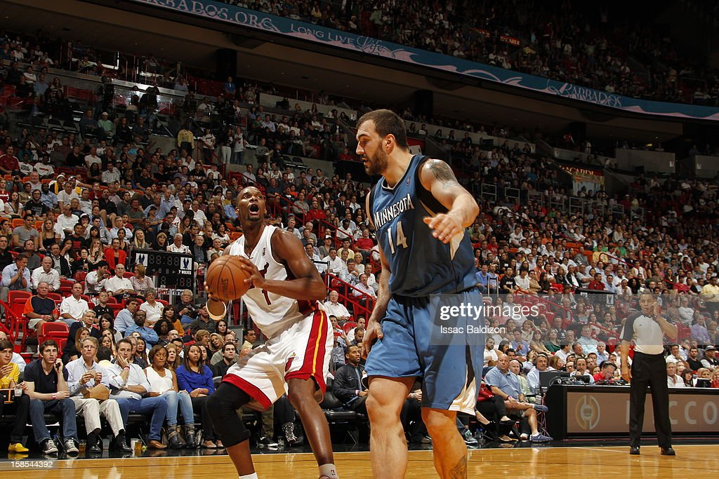 <a gi-track='captionPersonalityLinkClicked' href=/galleries/search?phrase=Chris+Bosh&family=editorial&specificpeople=201574 ng-click='$event.stopPropagation()'>Chris Bosh</a> #1 of the Miami Heat protects the ball from <a gi-track='captionPersonalityLinkClicked' href=/galleries/search?phrase=Nikola+Pekovic&family=editorial&specificpeople=829137 ng-click='$event.stopPropagation()'>Nikola Pekovic</a> #14 of the Minnesota Timberwolves during a game between the Minnesota Timberwolves and the Miami Heat on December 18, 2012 at American Airlines Arena in Miami, Florida.