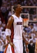 Chris Bosh of the Miami Heat reacts after a play in the second half against the Indiana Pacers during Game Two of the Eastern Conference Finals at...