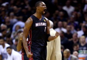 Chris Bosh of the Miami Heat reacts against the San Antonio Spurs during Game Two of the 2014 NBA Finals at the ATT Center on June 8 2014 in San...