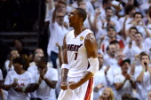 Chris Bosh of the Miami Heat reacts in the first half against the Oklahoma City Thunder in Game Five of the 2012 NBA Finals on June 21 2012 at...