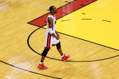 Chris Bosh of the Miami Heat reacts in the first half against the Indiana Pacers during Game Seven of the Eastern Conference Finals of the 2013 NBA...