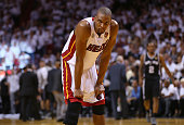Chris Bosh of the Miami Heat reacts late in the fourth quarter while taking on the San Antonio Spurs during Game Six of the 2013 NBA Finals at...