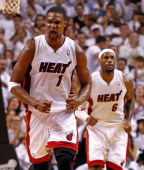 Chris Bosh of the Miami Heat reacts to a basket during Game Two of the Eastern Conference Quarterfinals in the 2012 NBA Playoffs against the New York...