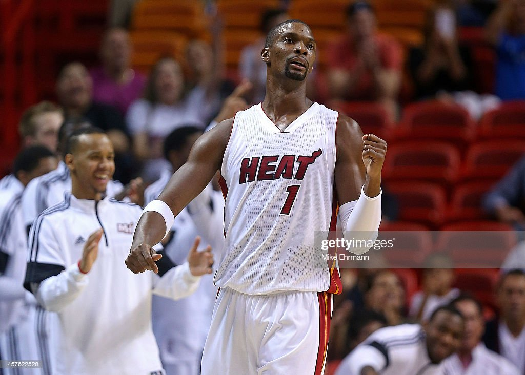 <a gi-track='captionPersonalityLinkClicked' href=/galleries/search?phrase=Chris+Bosh&family=editorial&specificpeople=201574 ng-click='$event.stopPropagation()'>Chris Bosh</a> #1 of the Miami Heat reacts to a play during a preseason game against the Houston Rockets at American Airlines Arena on October 21, 2014 in Miami, Florida.