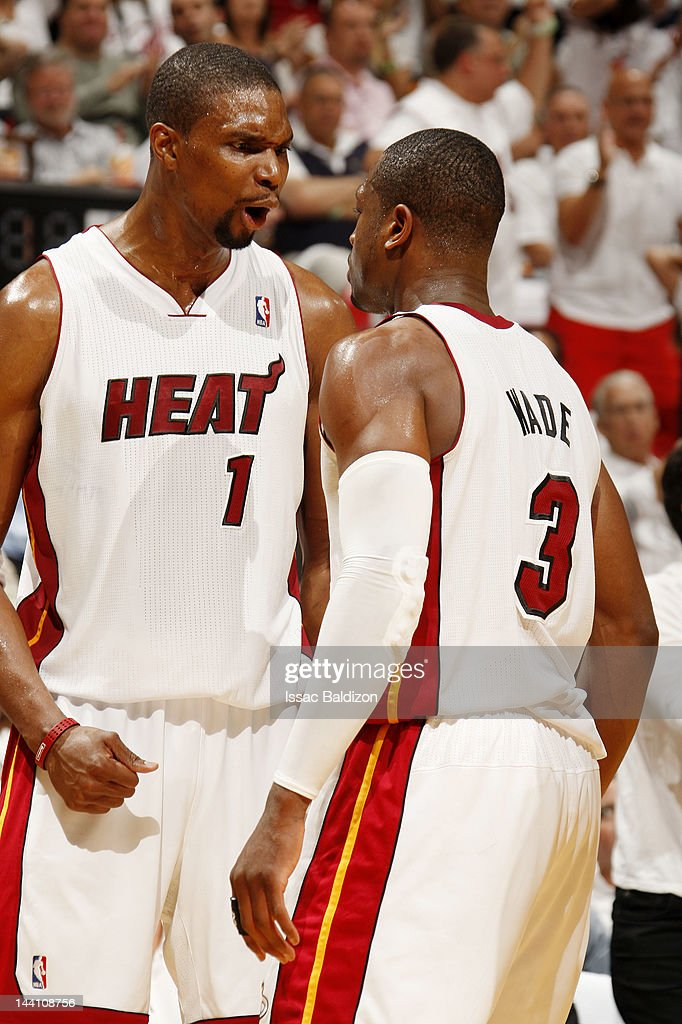 <a gi-track='captionPersonalityLinkClicked' href=/galleries/search?phrase=Chris+Bosh&family=editorial&specificpeople=201574 ng-click='$event.stopPropagation()'>Chris Bosh</a> #1 of the Miami Heat reacts to the game action with teammate <a gi-track='captionPersonalityLinkClicked' href=/galleries/search?phrase=Dwyane+Wade&family=editorial&specificpeople=201481 ng-click='$event.stopPropagation()'>Dwyane Wade</a> #3 in Game Five of the Eastern Conference Quarterfinals against the New York Knicks during the 2012 NBA Playoffs on May 9, 2012 at American Airlines Arena in Miami, Florida.