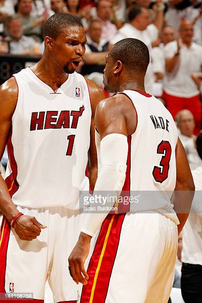 Chris Bosh of the Miami Heat reacts to the game action with teammate Dwyane Wade in Game Five of the Eastern Conference Quarterfinals against the New...