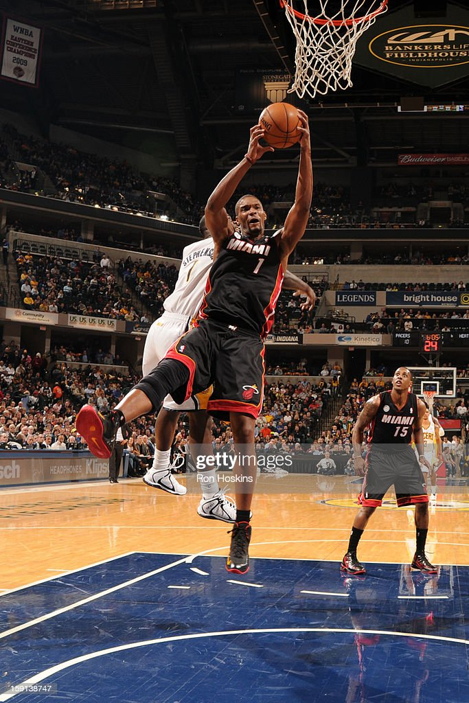 Chris Bosh #1 of the Miami Heat rebounds against Lance Stephenson #1 of the Indiana Pacers on January 8, 2013 at Bankers Life Fieldhouse in Indianapolis, Indiana.