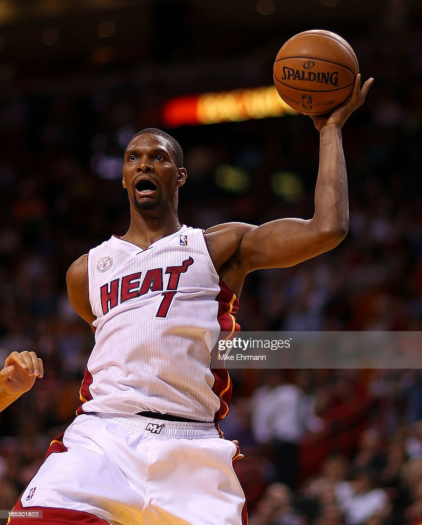 Chris Bosh #1 of the Miami Heat rebounds during a game against the New York Knicks at American Airlines Arena on April 2, 2013 in Miami, Florida.