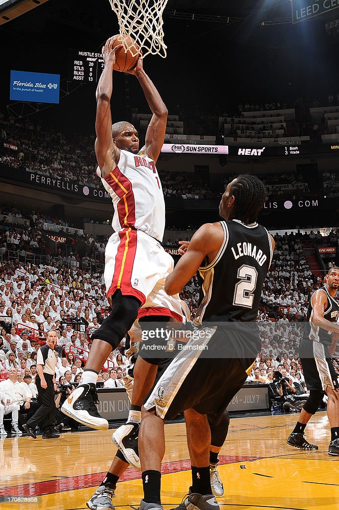 Chris Bosh #1 of the Miami Heat rebounds the basketball during Game Six of the 2013 NBA Finals against the San Antonio Spurs on June 18, 2013 at the American Airlines Arena in Miami, Florida.