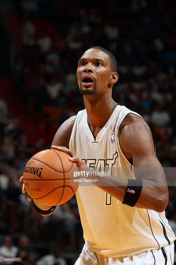 Chris Bosh #1 of the Miami Heat shoots a free throw against the Brooklyn Nets on December 1, 2012 at American Airlines Arena in Miami, Florida.