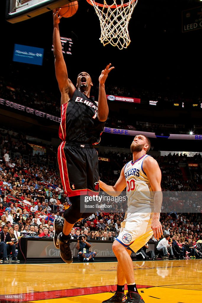 Chris Bosh #1 of the Miami Heat shoots a layup against Spencer Hawes #00 of the Philadelphia 76ers on March 8, 2013 at American Airlines Arena in Miami, Florida.