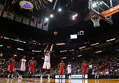 Chris Bosh of the Miami Heat shoots a technical free throw during a game against the Houston Rockets at American Airlines Arena on November 4 2014 in...