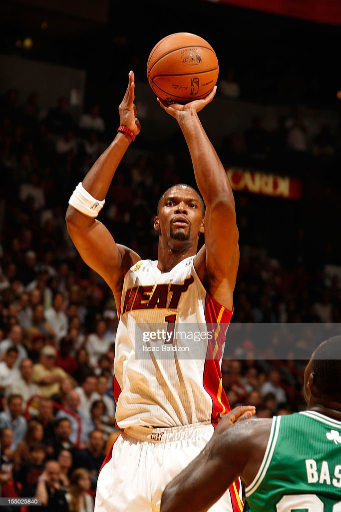 <a gi-track='captionPersonalityLinkClicked' href=/galleries/search?phrase=Chris+Bosh&family=editorial&specificpeople=201574 ng-click='$event.stopPropagation()'>Chris Bosh</a> #1 of the Miami Heat shoots against <a gi-track='captionPersonalityLinkClicked' href=/galleries/search?phrase=Brandon+Bass&family=editorial&specificpeople=233806 ng-click='$event.stopPropagation()'>Brandon Bass</a> #30 of the Boston Celtics during the NBA game on October 30, 2012 at American Airlines Arena in Miami, Florida.