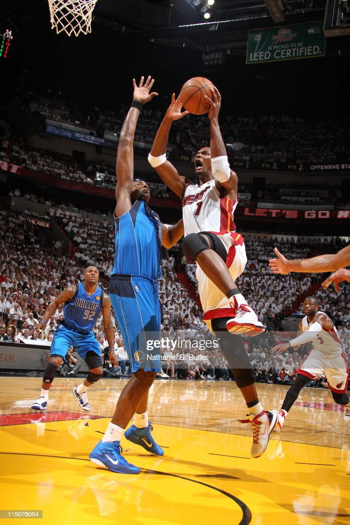 Chris Bosh #1 of the Miami Heat shoots against Brendan Haywood #33 of the Dallas Mavericks during Game Two of the 2011 NBA Finals on June 02, 2011 at the American Airlines Arena in Miami, Florida.