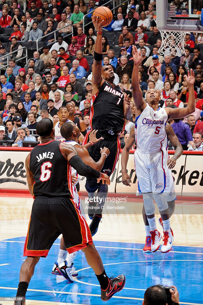 <a gi-track='captionPersonalityLinkClicked' href=/galleries/search?phrase=Chris+Bosh&family=editorial&specificpeople=201574 ng-click='$event.stopPropagation()'>Chris Bosh</a> #1 of the Miami Heat shoots against <a gi-track='captionPersonalityLinkClicked' href=/galleries/search?phrase=Caron+Butler&family=editorial&specificpeople=201744 ng-click='$event.stopPropagation()'>Caron Butler</a> #5 of the Los Angeles Clippers at the Staples Center on November 14, 2012 in Los Angeles, California.