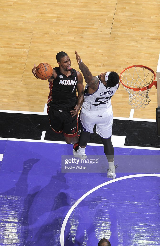 <a gi-track='captionPersonalityLinkClicked' href=/galleries/search?phrase=Chris+Bosh&family=editorial&specificpeople=201574 ng-click='$event.stopPropagation()'>Chris Bosh</a> #1 of the Miami Heat shoots against James Johnson #52 of the Miami Heat on January 12, 2013 at Sleep Train Arena in Sacramento, California.