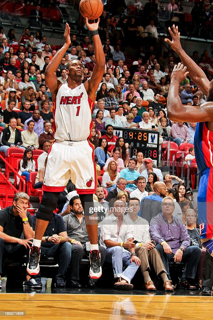 Chris Bosh #1 of the Miami Heat shoots against Jason Maxiell #54 of the Detroit Pistons on January 25, 2013 at American Airlines Arena in Miami, Florida.