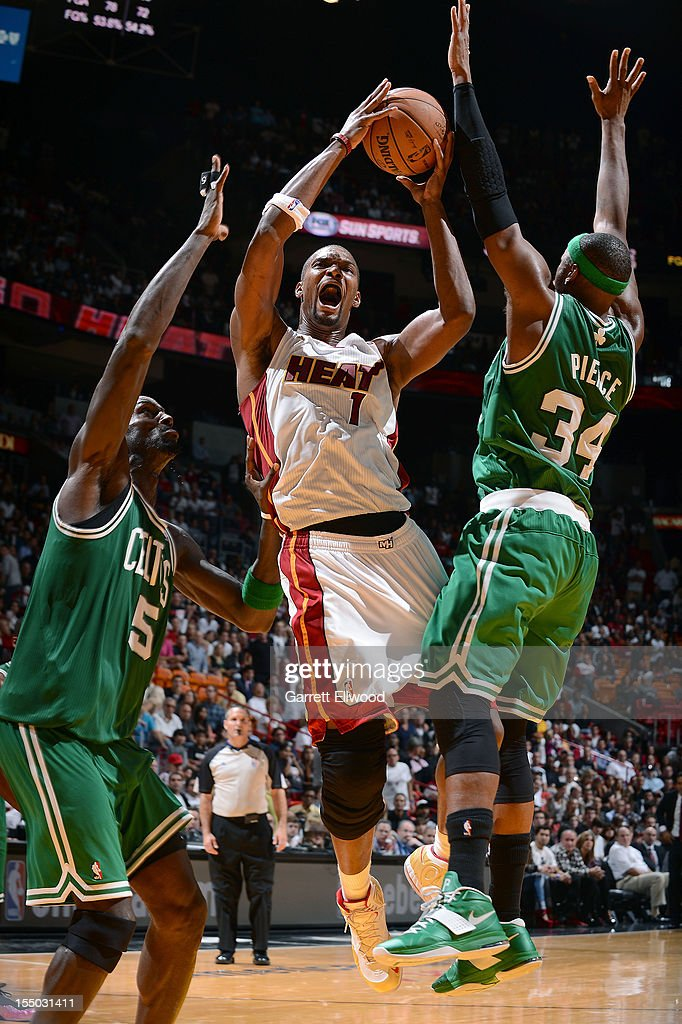 Chris Bosh #1 of the Miami Heat shoots against (L-R) Kevin Garnett #5 and Paul Pierce #34 of the Boston Celtics during the NBA game on October 30, 2012 at American Airlines Arena in Miami, Florida.