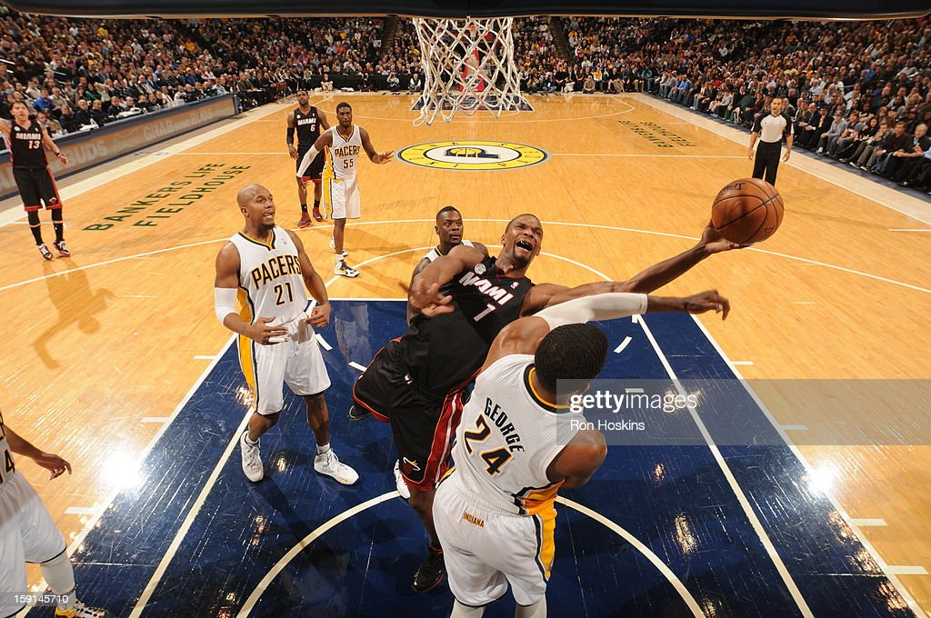 <a gi-track='captionPersonalityLinkClicked' href=/galleries/search?phrase=Chris+Bosh&family=editorial&specificpeople=201574 ng-click='$event.stopPropagation()'>Chris Bosh</a> #1 of the Miami Heat shoots against Paul George #24 of the Indiana Pacers on January 8, 2013 at Bankers Life Fieldhouse in Indianapolis, Indiana.