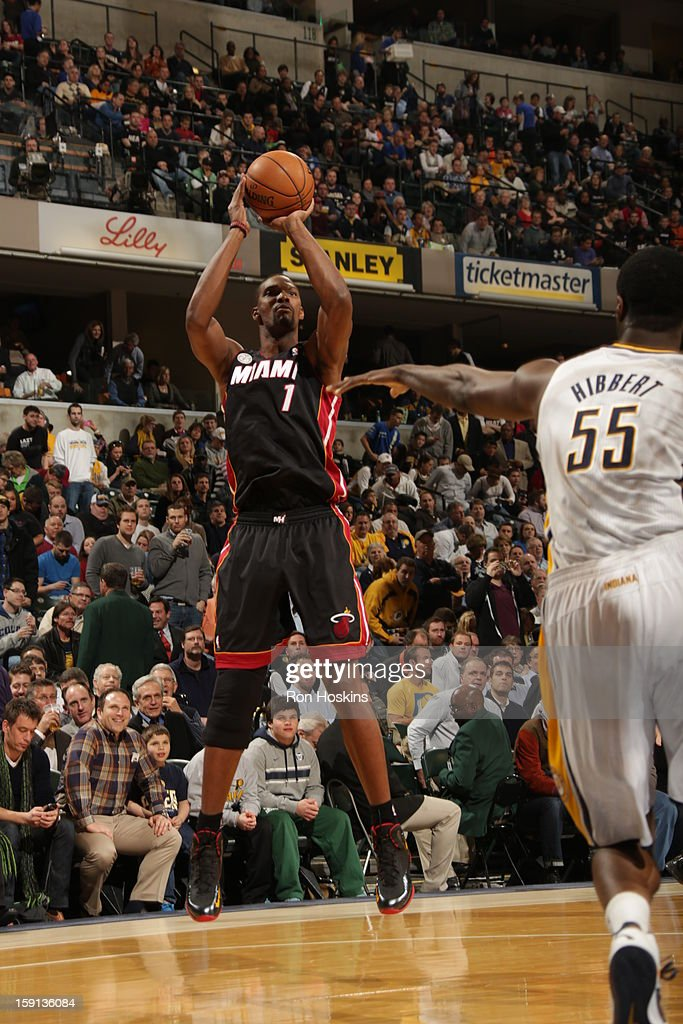 Chris Bosh #1 of the Miami Heat shoots against Roy Hibbert #55 of the Indiana Pacers on January 8, 2013 at Bankers Life Fieldhouse in Indianapolis, Indiana.