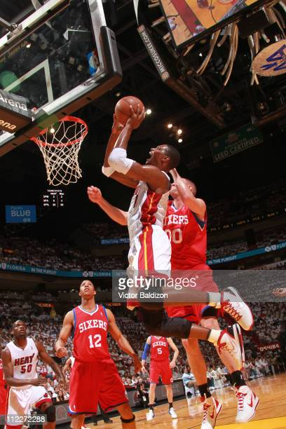 Chris Bosh of the Miami Heat shoots against Spencer Hawes of the Philadelphia 76ers in Game One of the Eastern Conference Quarterfinals between the...