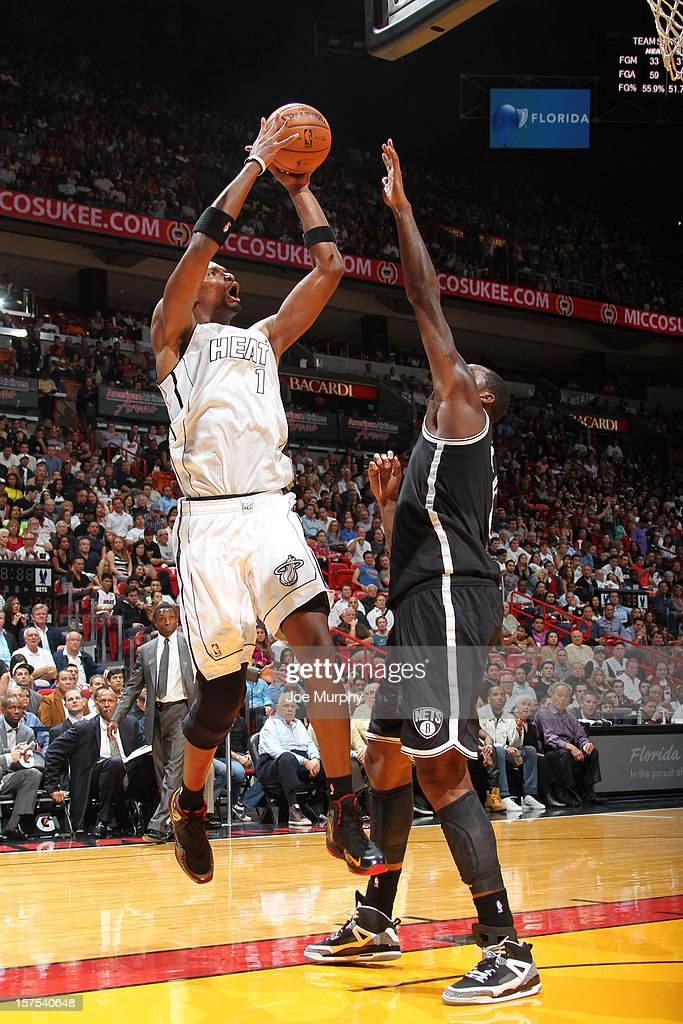 Chris Bosh #1 of the Miami Heat shoots against the Brooklyn Nets on December 1, 2012 at American Airlines Arena in Miami, Florida.