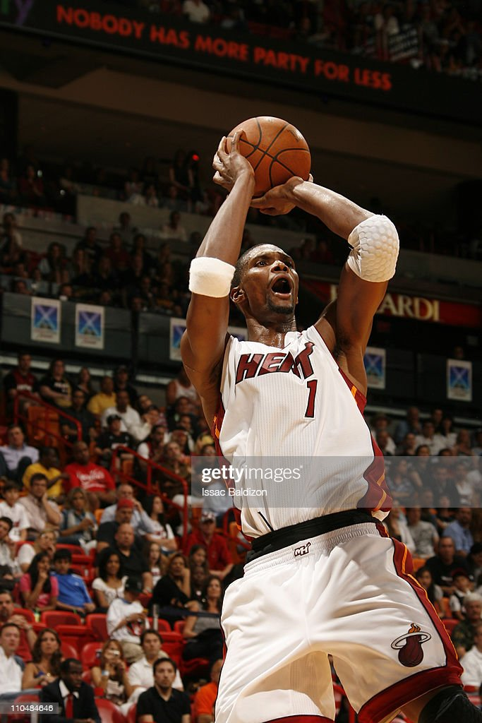 <a gi-track='captionPersonalityLinkClicked' href=/galleries/search?phrase=Chris+Bosh&family=editorial&specificpeople=201574 ng-click='$event.stopPropagation()'>Chris Bosh</a> #1 of the Miami Heat shoots against the Denver Nuggets on March 19, 2011 at American Airlines Arena in Miami, Florida.