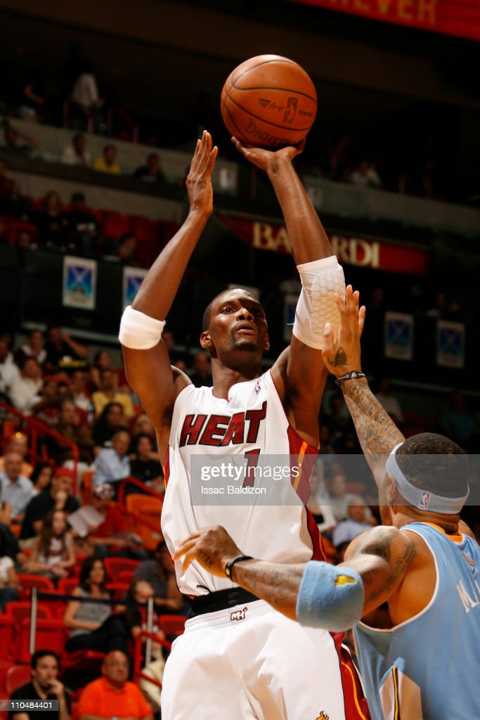 <a gi-track='captionPersonalityLinkClicked' href=/galleries/search?phrase=Chris+Bosh&family=editorial&specificpeople=201574 ng-click='$event.stopPropagation()'>Chris Bosh</a> #1 of the Miami Heat shoots over <a gi-track='captionPersonalityLinkClicked' href=/galleries/search?phrase=Kenyon+Martin&family=editorial&specificpeople=201522 ng-click='$event.stopPropagation()'>Kenyon Martin</a> #4 of the Denver Nuggets on March 19, 2011 at American Airlines Arena in Miami, Florida.